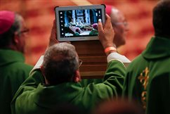 Stop taking smartphone snapshots during Mass, pope says