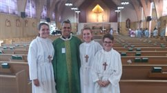 Siblings serve Mass together