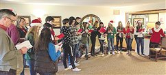 Youth group brings Christmas cheer to community