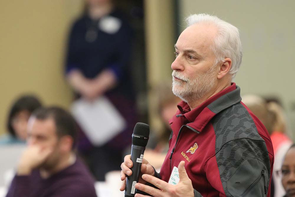 John Garrow, principal of Central Catholic High School, advocates for shared staff during a Jan. 20 gathering of educators to discuss a strategic plan for Archdiocese of Portland Schools. (Ed Langlois/Catholic Sentinel)