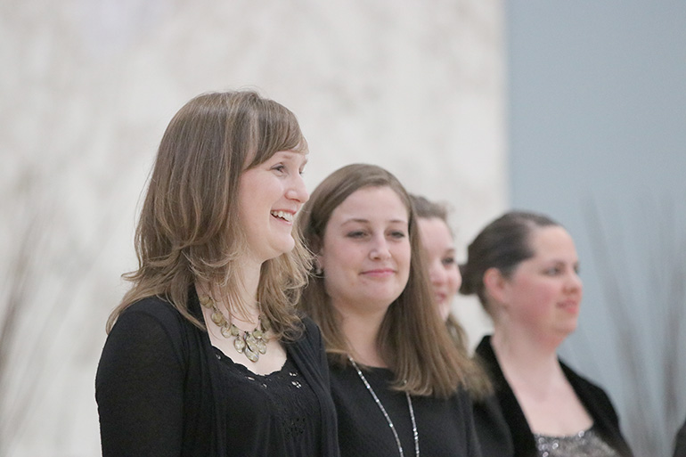 Rebekah Gilmore smiles after performing with the Tudor Choir presented by Cappella Romana, which was invited to sing at St. Matthew Parish as part of an effort to bring a diverse repertoire of sacred music to Portland's Westside.