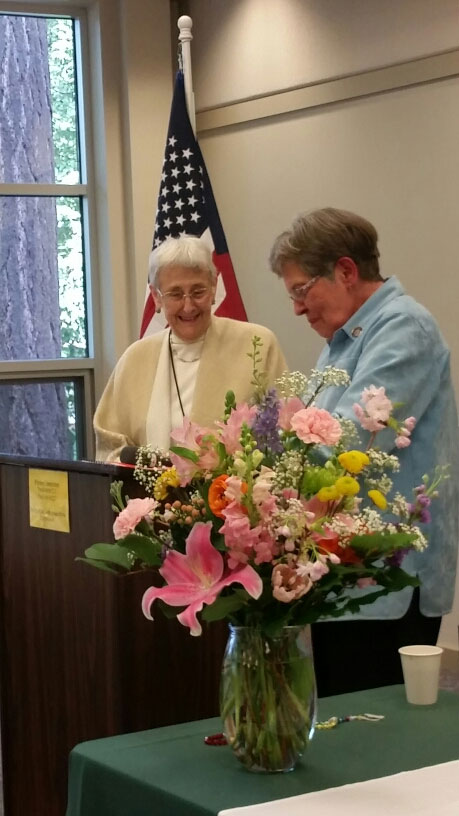Glenda McCall, left, receives an honor as Archdiocesan Council of Catholic Women's Woman of Achievement for 2018 from Barbara Francescon. The recognition was part of the April 21 ACCW convention at the Grotto. (Courtesy ACCW)