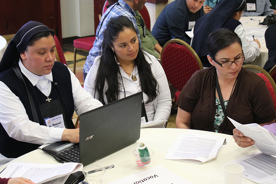 Sr. Raquel De Leon types up notes as Victoria Rodriguez of the Diocese of Boise, Idaho, and Maria Elena Ruiz of the Archdiocese of Portland listen at the regional gathering of V Encuentro, held in Portland June 22-24. The needs and concerns of youths was one of the primary topics discussed. (Katie Scott/Catholic Sentinel)