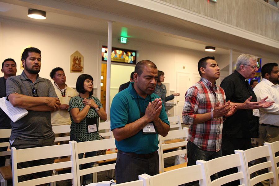 Delegates to the regional gathering of V Encuentro pray during the opening Mass at St. Michael the Archangel Church June 22. (Francisco Lara/Catholic Sentinel)