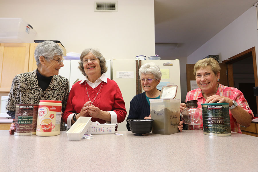 Hidden ministry: Crew quietly makes sure parish kitchen is well stocked, creating space for hospitality