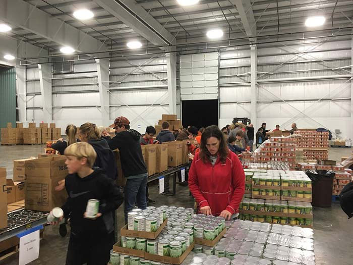Volunteers assemble Christmas food boxes last year in an airplane hangar at Southwest Oregon Regional Airport in North Bend. The annual project, organized by the Knights of Columbus, feeds 1,300 households. (Courtesy Knights of Columbus Council 1261)
