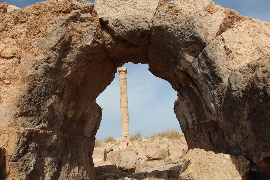 An arch and column stand at Mukawir, Jordan, site of King Herod's palace, where John the Baptist was imprisoned and executed. (Ed Langlois/Catholic Sentinel)