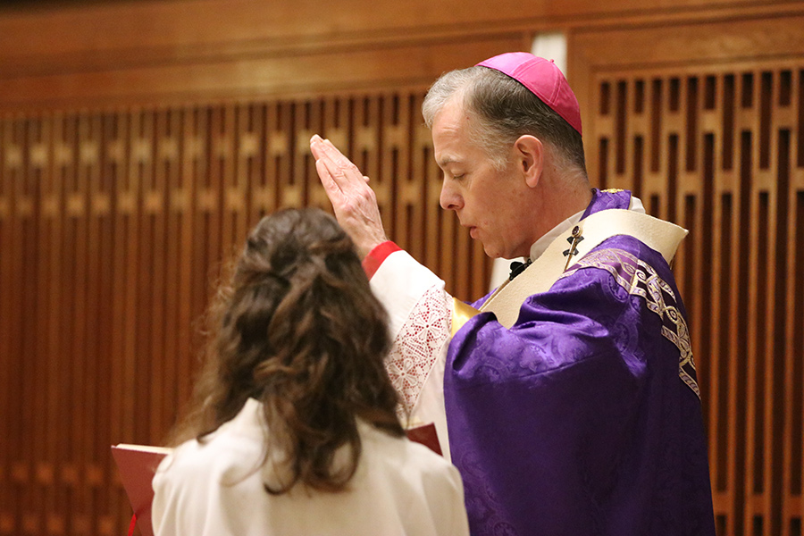 Archbishop Sample prays over confirmation candidates at the University of Portland earlier this spring. The prayer calls for the Holy Spirit to fill the young people being confirmed. (Sarah Wolf/Catholic Sentinel)