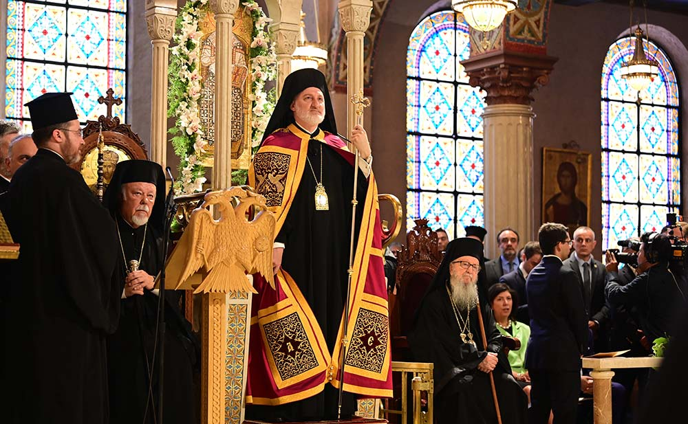 Archbishop Elpidophoros of America stands with his crosier during his enthronement as the seventh archbishop of the Greek Orthodox Archdiocese of America at the Cathedral of the Holy Trinity in the Manhattan borough of New York City June 22, 2019. Also pictured are retired Metropolitan Avgoustinos of Germany and Archbishop Demetrios, who headed the Greek Orthodox Archdiocese of America from 1999 to 2019. (CNS photo/Dimitrois Panagos, courtesy GOA)