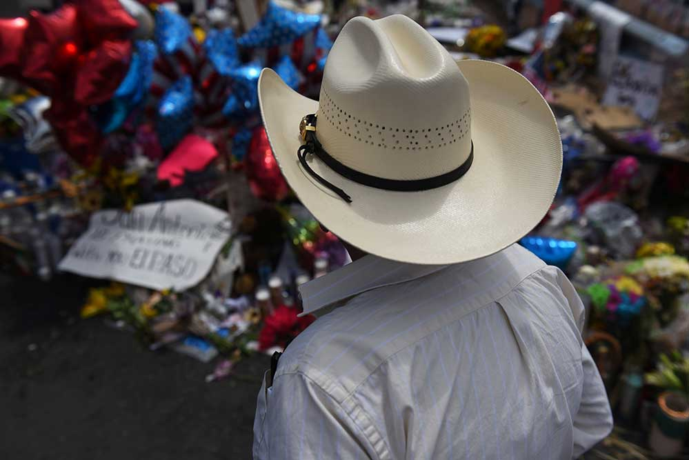 A man pays his respects Aug. 8, 2019, at a memorial five days after a mass shooting Aug. 3 at a Walmart store in El Paso, Texas. (CNS photo/Callaghan O'Hare, Reuters)