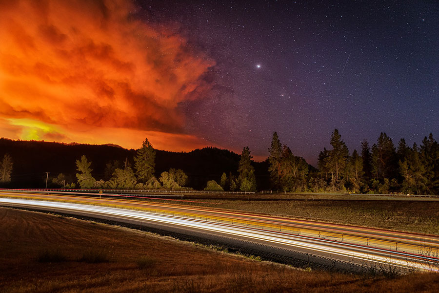 The Milepost 97 Fire lights up the sky in late July in Southern Oregon. Smoke from fires in the area tends to settle in towns like Grants Pass, Medford and Ashland. (Courtesy Douglas Forest Protective Association)