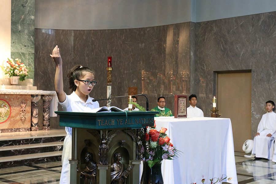 Erika Paez leads the faithful in singing the responsorial psalm.