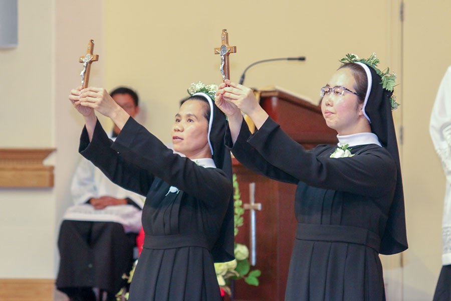 Sr. Elizabeth Thanh Ly Tran and Sr. Maria Quynh Nhu Dang profess perpetual vows July 20 during a celebration at Our Lady of La Vang Parish for the Adorers of the Holy Cross Sisters in Portland. (Thi Pham/Our Lady of La Vang Parish)