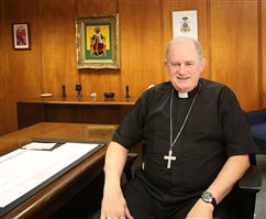Bishop Smith's views were shaped by his parents' longtime work with St. Vincent de Paul Society