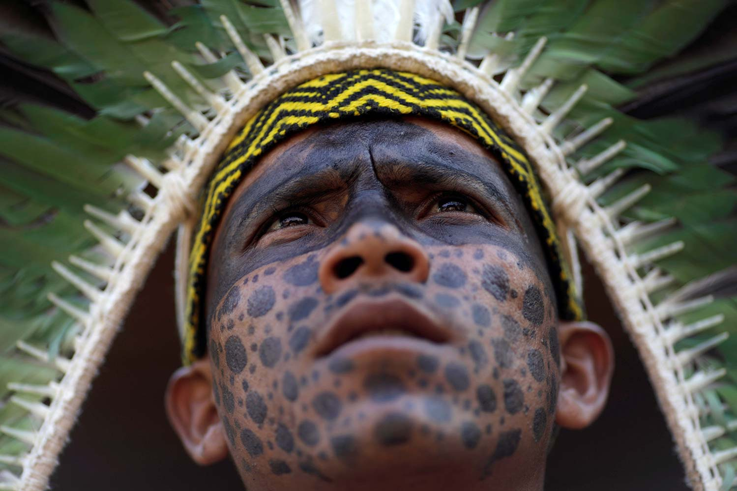 An man from the Shanenawa tribe observes an indigenous dance during a festival to celebrate nature and ask for an end to the burning of the Amazon Sept. 1 in Feijo, Brazil. (CNS photo/Ueslei Marcelino, Reuters)