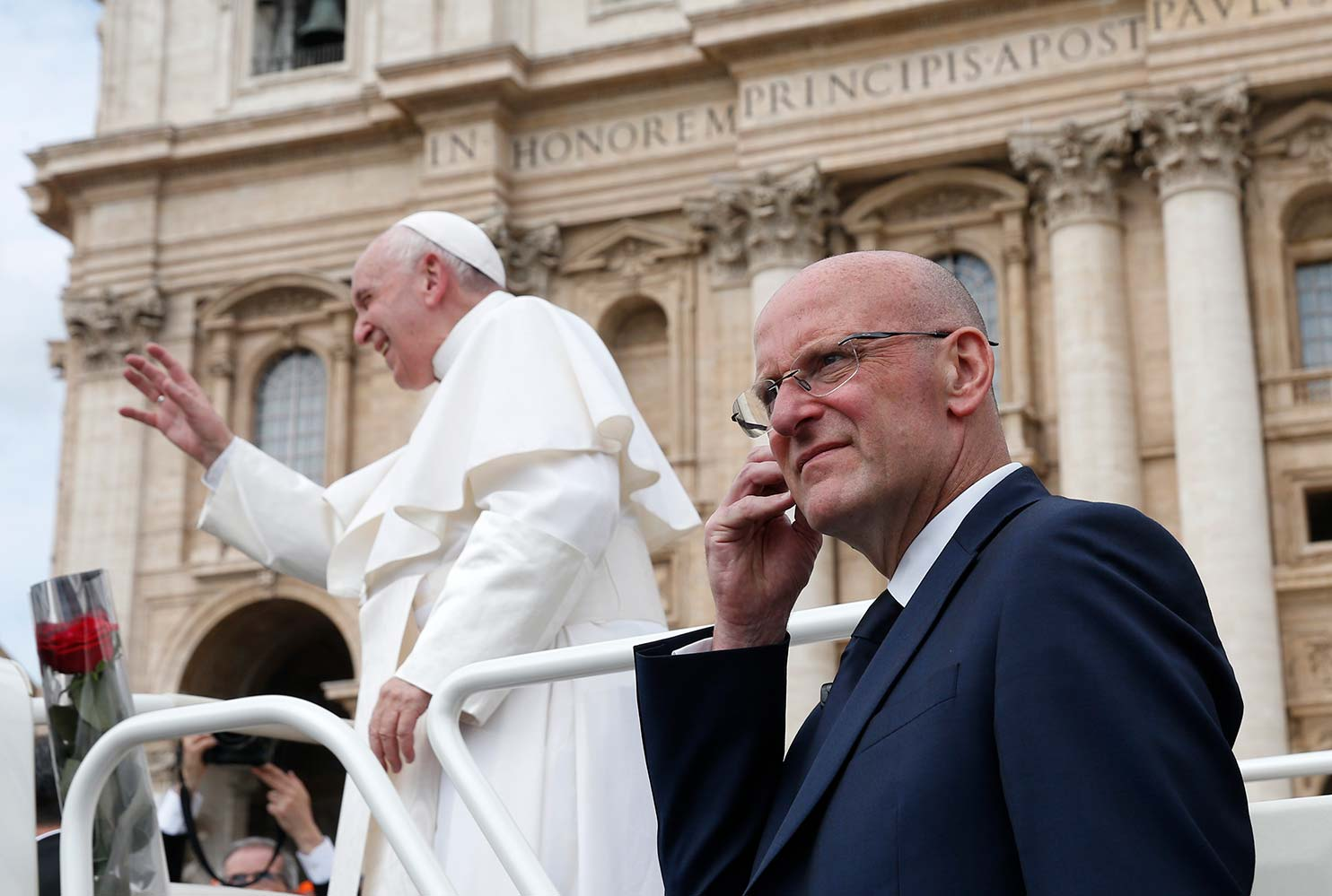 Domenico Giani, lead bodyguard for Pope Francis and head of the Vatican police force, keeps watch as the pope leaves his general audience in St. Peter's Square at the Vatican May 1. Pope Francis accepted the resignation of Giani Oct. 14, nearly two weeks after an internal security notice was leaked to the Italian press. (CNS photo/Paul Haring)