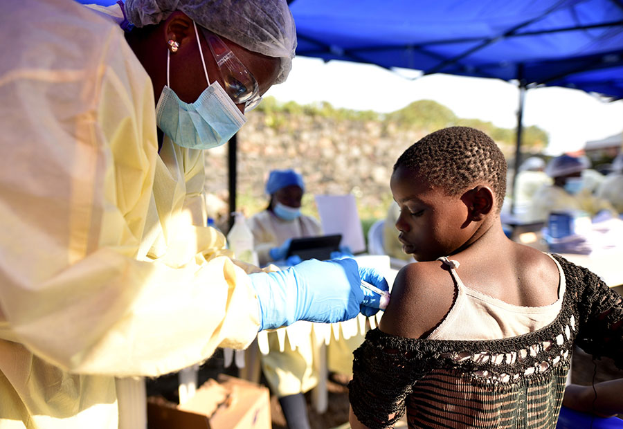 A Congolese health worker administers an Ebola vaccine to a child at the Himbi Health Centre in the Congo this July. (Olivia Acland, Reuters/CNS)