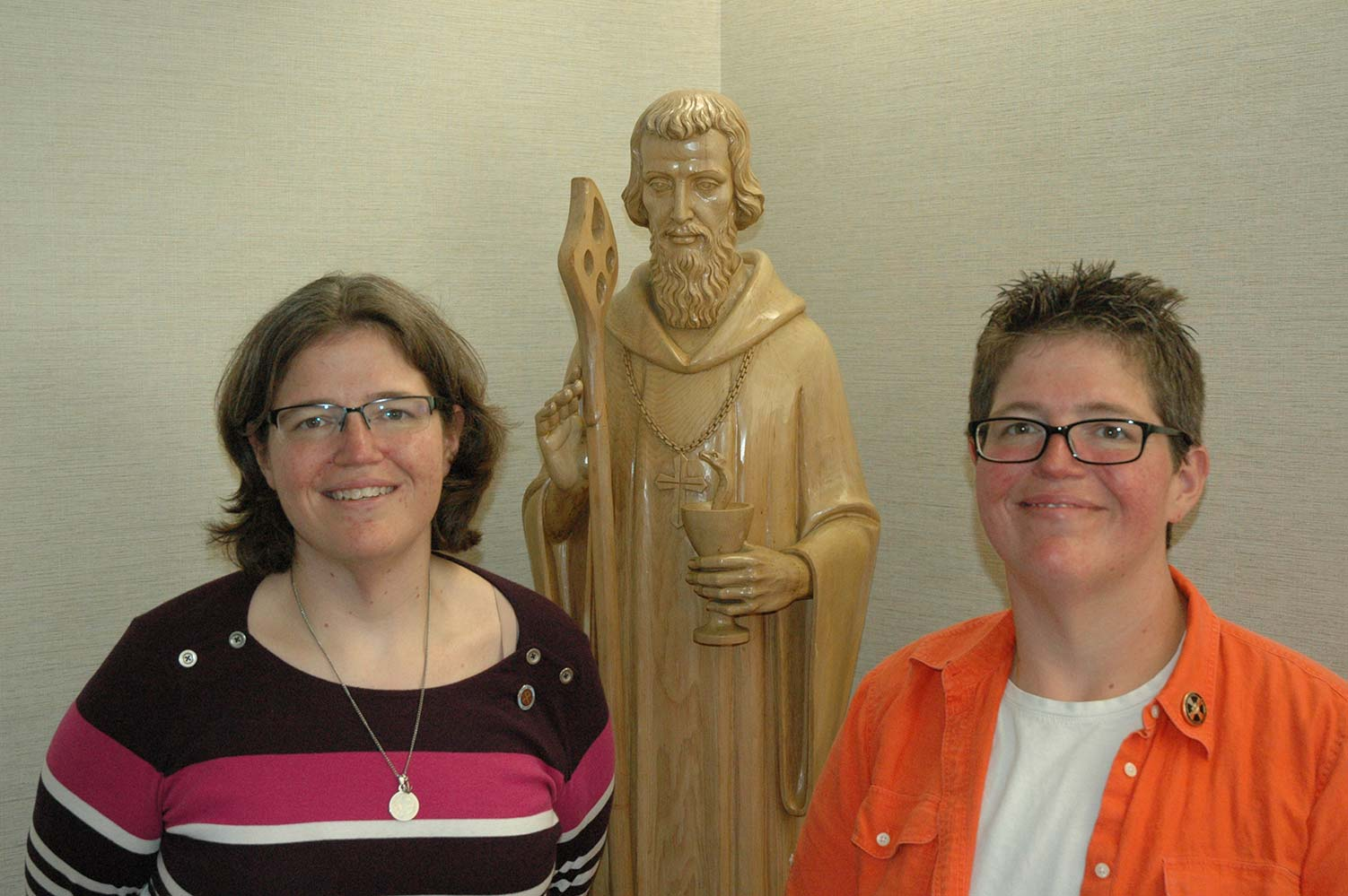Benedictine Sisters Susan and Jill Reuber, pictured in an undated photo in Indianapolis, have often shared the same path in life, but their roads to their religious vocations took different turns. The y were born within two minutes of each other as part of triplets with their brother Eric. (CNS photo/John Shaughnessy, The Criterion)