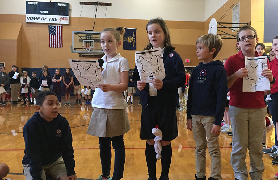 St. Agatha second graders Kobe Williams, Tatum Ruhnke, Cambell Krasneski, Britton Morris and Holden Walker pray the rosary while representing beads during a living rosary. It was one of the events held for the Sellwood school's Mary Week. (Courtesy St. Agatha School)