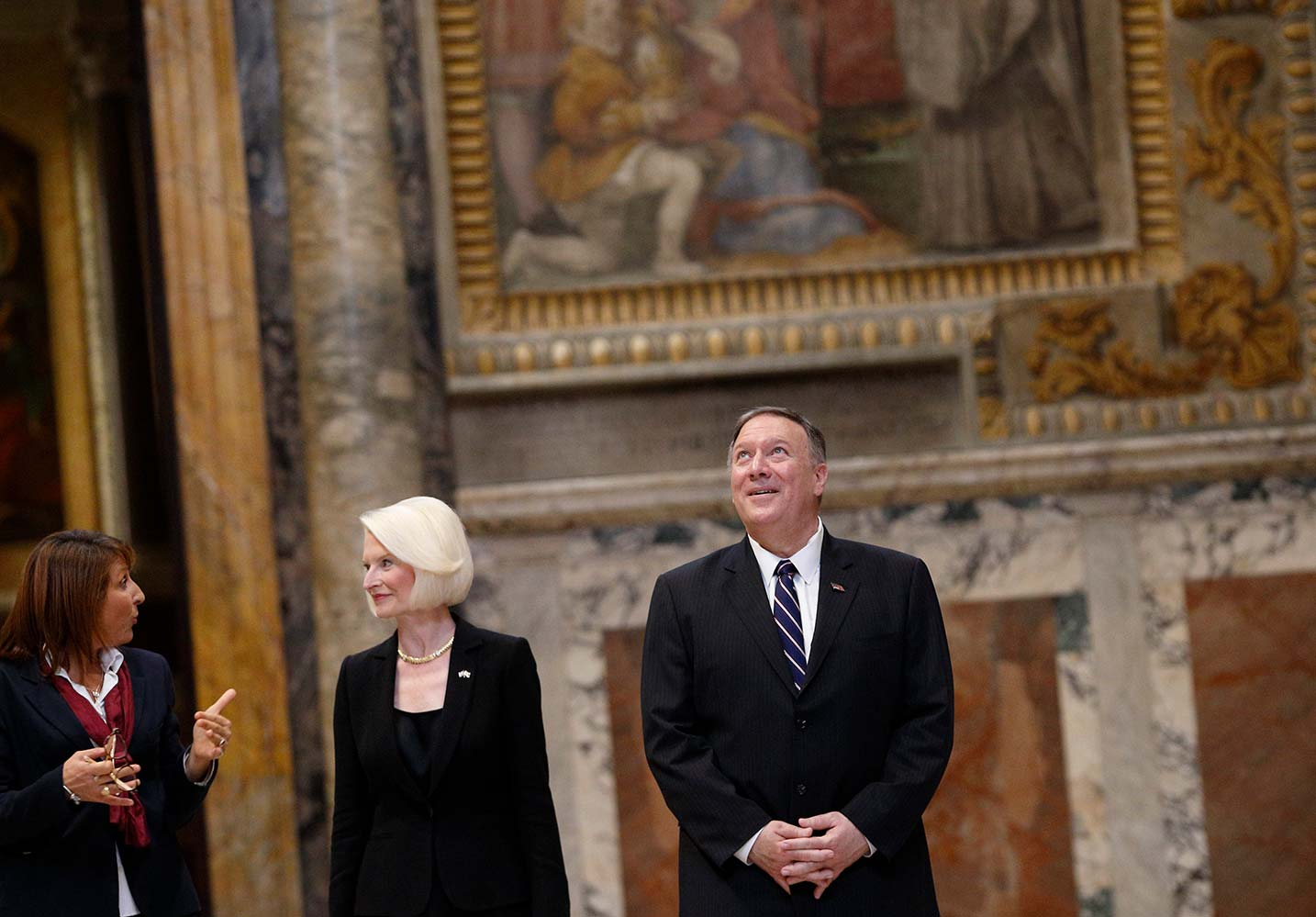 U.S. Secretary of State Mike Pompeo, and Callista Gingrich, U.S. ambassador to the Vatican, listen to a tour guide as they visit the Sala Regia at the Vatican Oct. 2, 2019. Secretary of State Pompeo toured the Vatican after speaking at a symposium sponsored by the U.S. Embassy to the Holy See at the Vatican. The symposium focused on areas of collaboration between the U.S. and the Vatican including the causes of advancing religious freedom and fighting against human trafficking. (CNS photo/Paul Haring)