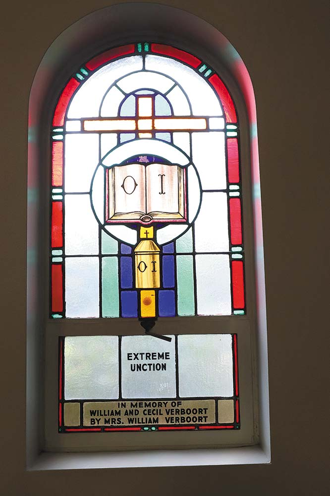 A window at Visitation Church in Verboort shows extreme unction, or anointing. (Ed Langlois/Catholic Sentinel)