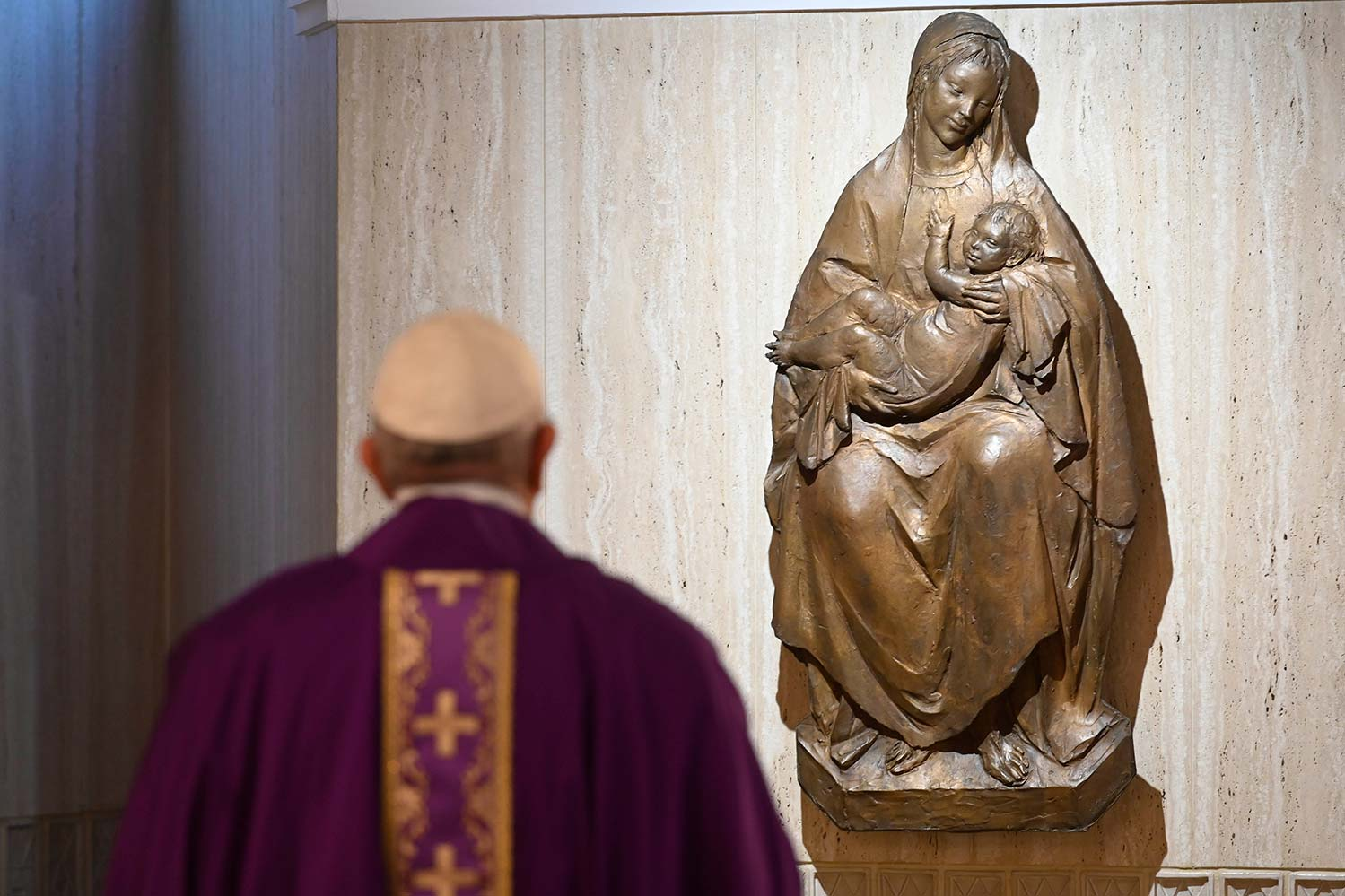Pope Francis prays before Mary at the end of a Mass March 12 in the chapel of his Vatican residence, the Domus Sanctae Marthae. At the beginning of the liturgy, the pope encouraged people to pray for their government leaders, who must make difficult decisions to contain the coronavirus pandemic. (CNS photo/Vatican Media)