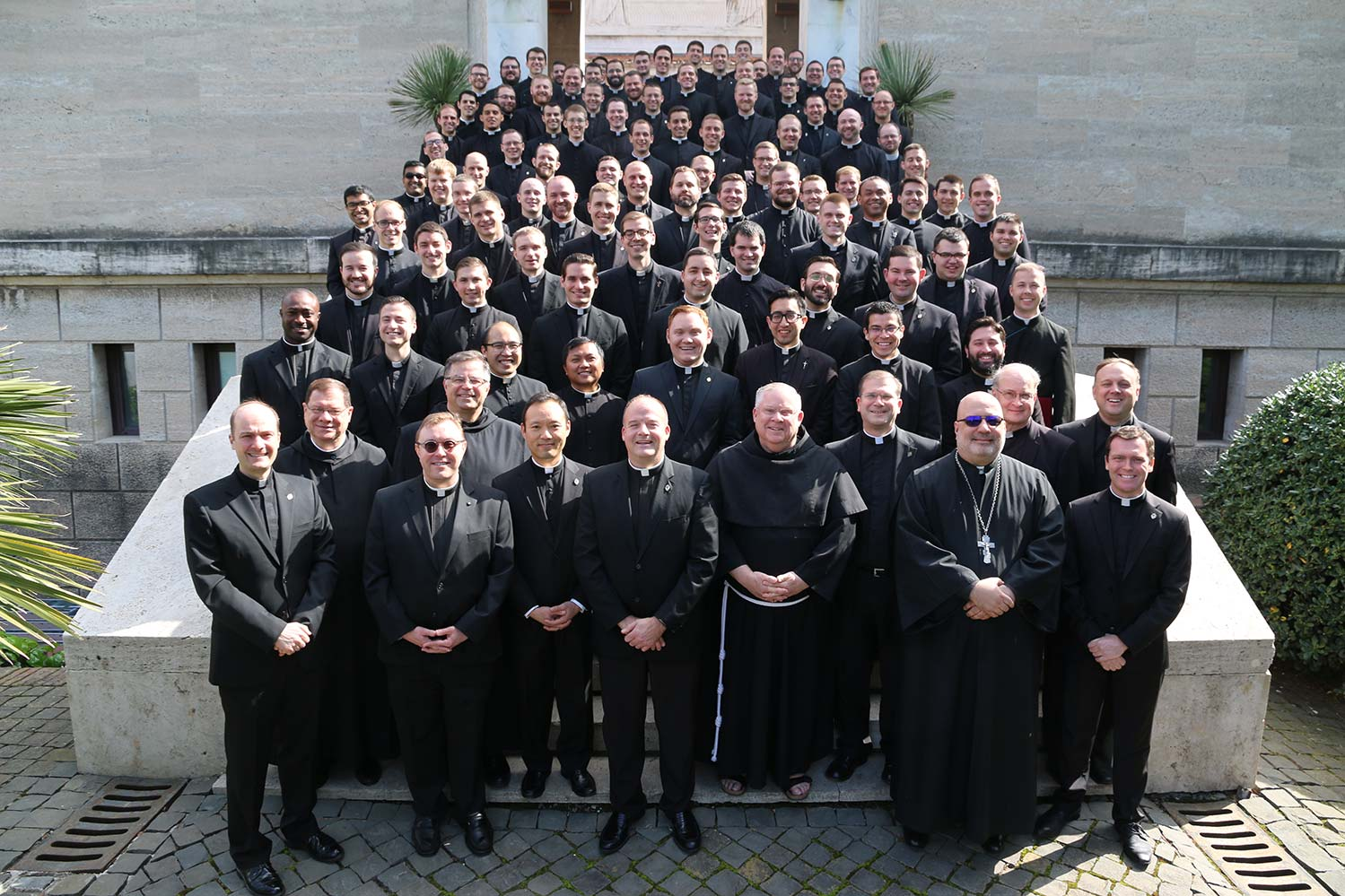 The staff and 92 seminarians at the Pontifical North American College in Rome pose for a photograph March 15 on the steps leading to the seminary chapel. Catholic News Agency reports the seminarians are being sent back to the United States. (Courtesy of the Pontifical North American College/CNS)