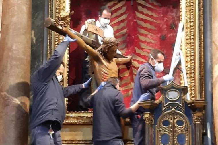 The miraculous crucifix is removed from the Church of San Marcello al Corso March 25. (Courtesy photo/CNA)