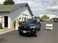 Priest prays over families in their vehicles