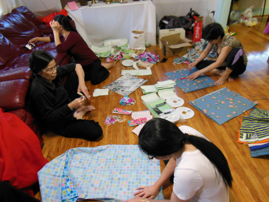 Relatives and friends of Peter Tran, a member of St. Rose of Lima Parish, gather to make face masks for health workers. (Courtesy Therese Ruesink)