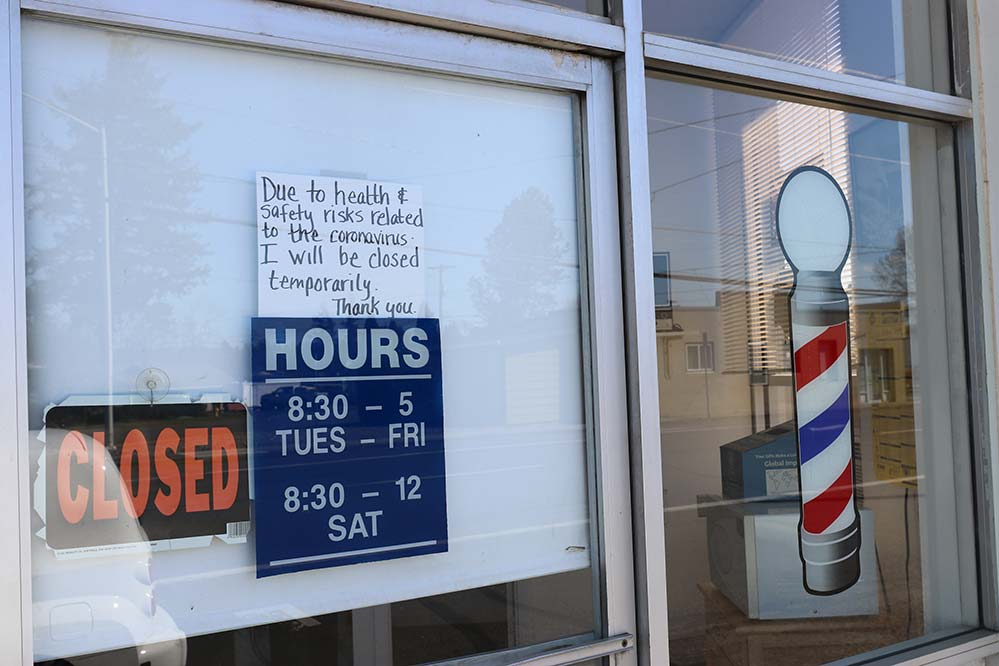 A sign on a barber shop in St. Helens announces closure in March amid pandemic. (Ed Langlois/Catholic Sentinel)