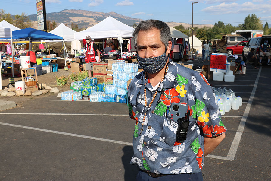 Ramiro Padilla stands in the parking lot of his Ashland restaurant, which he turned into an emergency feeding and distribution site for fire victims. (Ed Langlois/Catholic Sentinel)