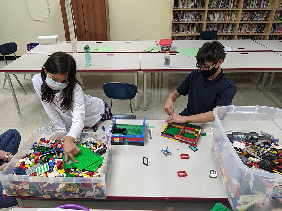 Third grader Naomi Rauch and her brother Nate, a sixth grader, work on a Lego challenge during one of the many after-school programs through St. Joseph School in Salem. (Courtesy St. Joseph School)