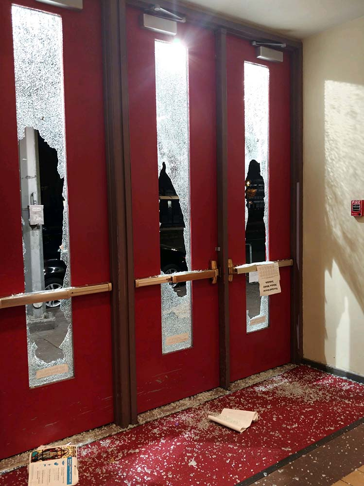 Glass from broken windows fills the foyer at St. André Bessette Church in downtown Portland. (Courtesy St. André Bessette Parish)