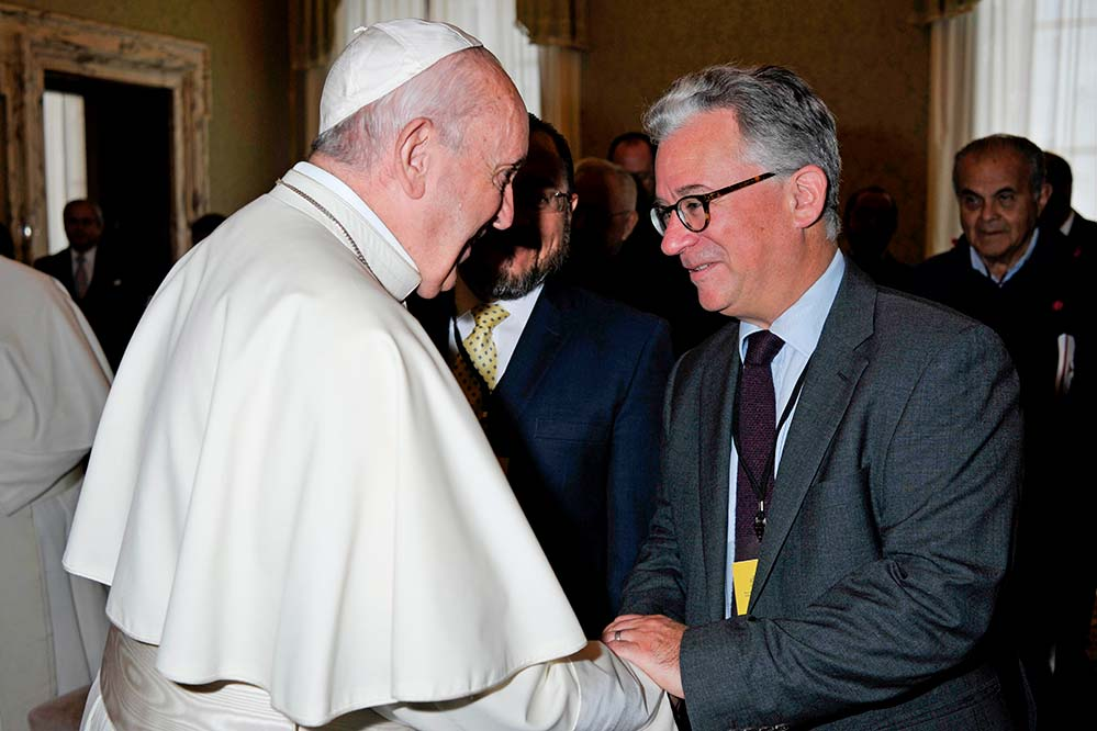 "Pope Francis meets author Austen Ivereigh at the Vatican in October 2019. The pope collaborated with Ivereigh on the book, ""Let Us Dream: The Path to A Better Future."" In the book the pope said he experienced three ""COVID moments"" in his lifetime: lung problems that threatened his life when he was 21; his ""displacement"" in Germany in 1986 for studies; and when he was sent away to Cordoba, Argentina, for almost two years in the early 1990s. ""Let Us Dream"" will be published Dec. 1 by Simon & Schuster. (CNS photo/Vatican Media)"