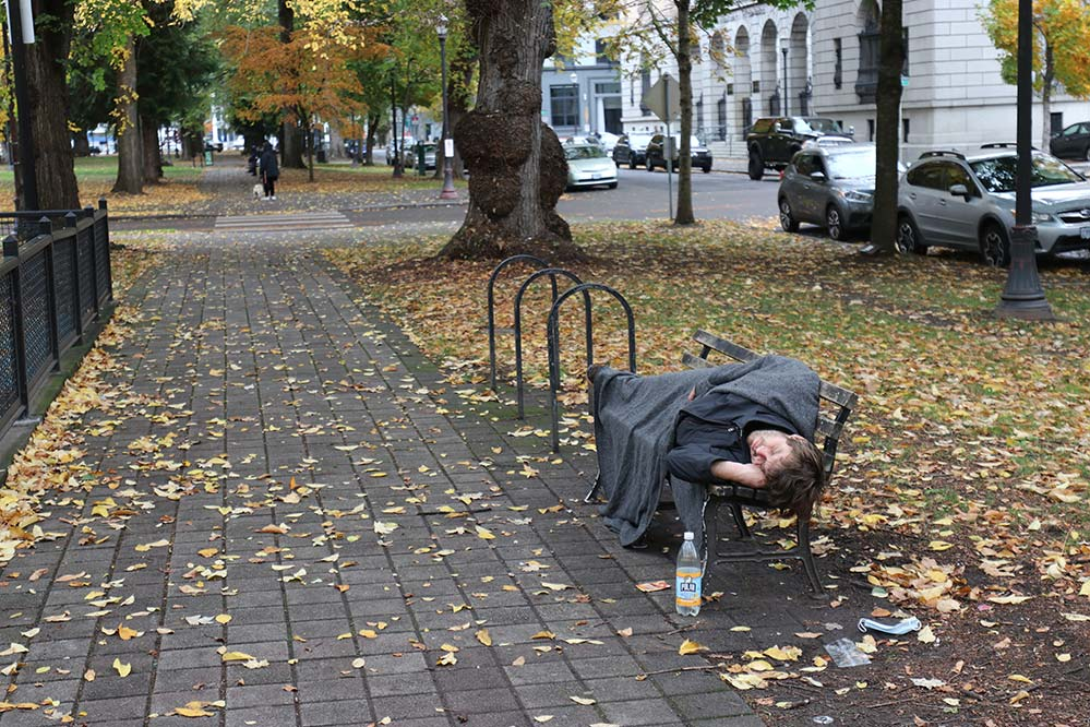 A man sleeps in the North Park Blocks in downtown Portland this fall. (Ed Langlois/Catholic Sentinel)