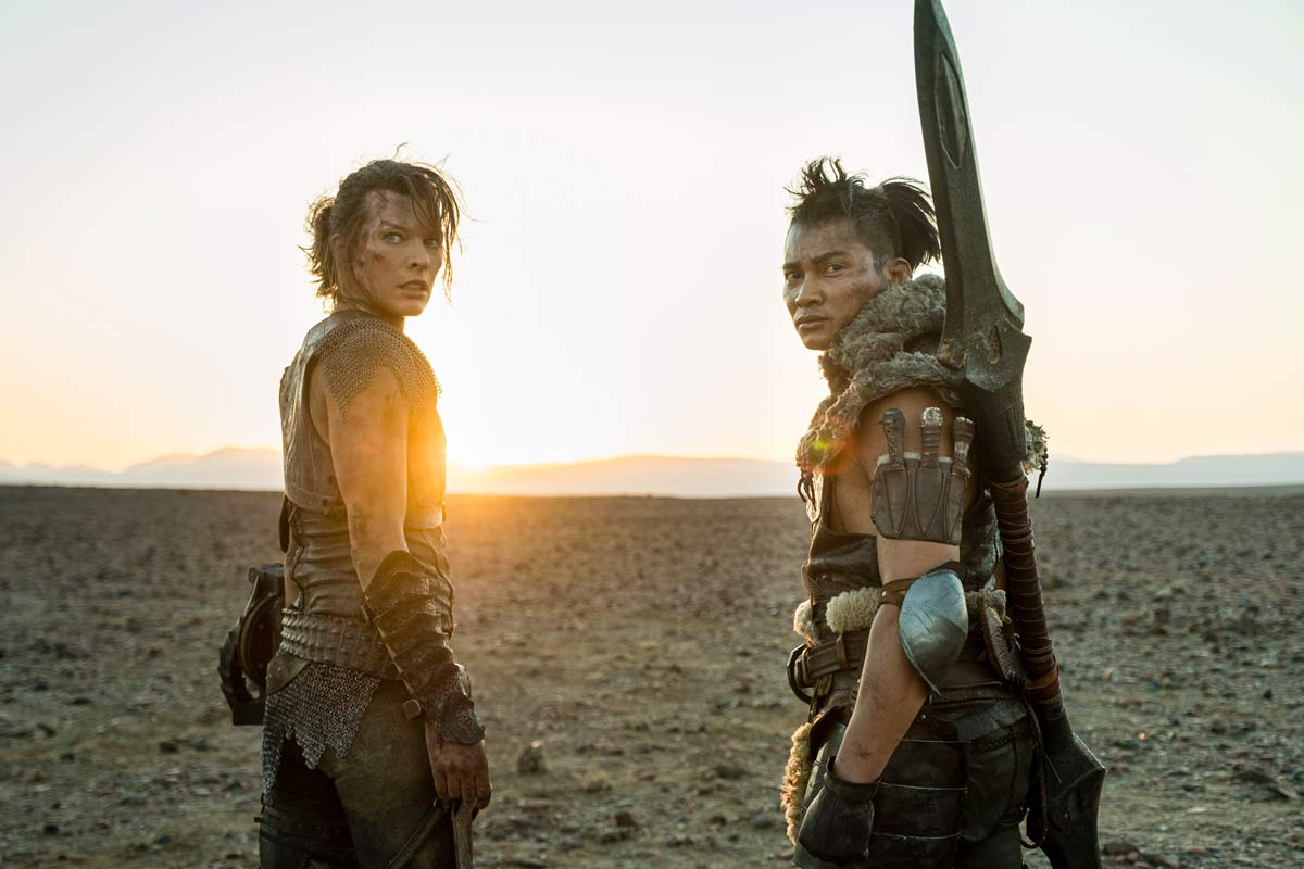 "Milla Jovovich and Tony Jaa star in a scene from the movie ""Monster Hunter."" The Catholic News Service classification is A-III — adults. The Motion Picture Association rating is PG-13 — parents strongly cautioned. Some material may be inappropriate for children under 13. (CNS photo/Coco Van Oppens, Constantin Film)"