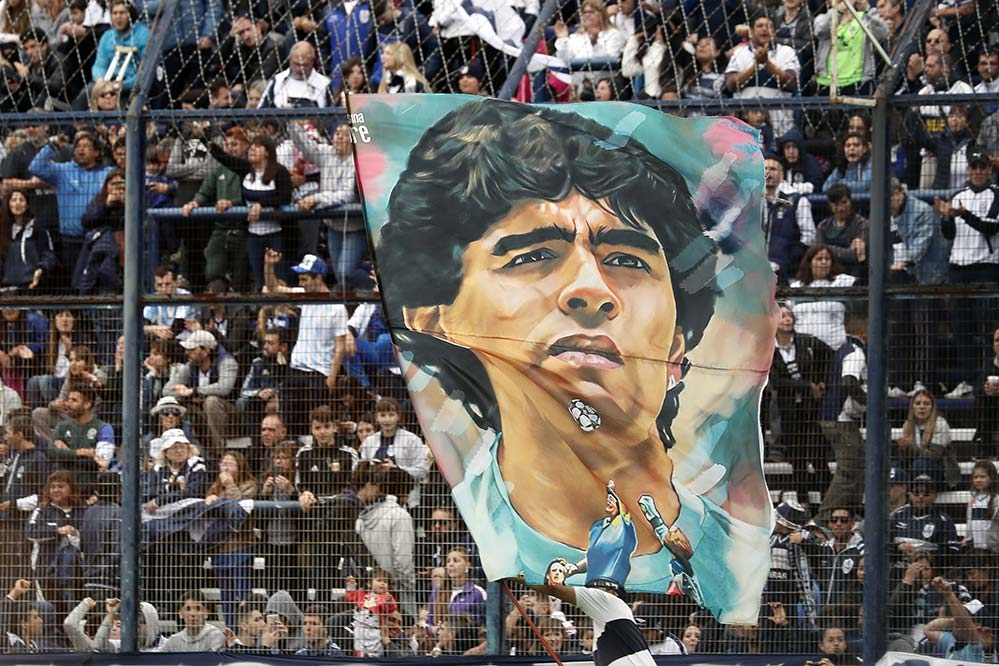 A banner with the image of the late soccer legend Diego Maradona is displayed at a stadium in Buenos Aires, Argentina, in 2019. Pope Francis said Maradona -- who died in November 2020 -- gave joy to millions of people. (CNS photo/Javier Garcia Martino, Reuters)
