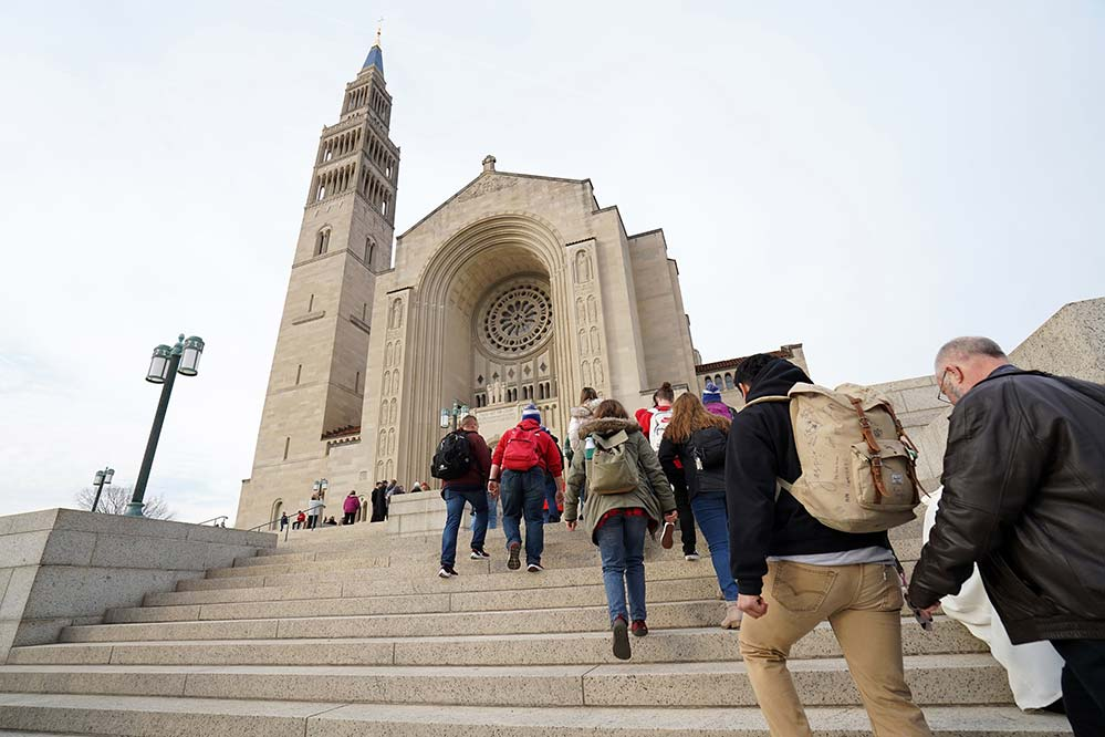 People arrive for the National Prayer Vigil for Life Jan. 23, 2020, at the Basilica of the National Shrine of the Immaculate Conception in Washington. Because of the coronavirus pandemic, the 2021 vigil will only be broadcast Jan. 28 at 8 P.M. ET, and then bishops from across the country will take turns leading livestreamed Holy Hours throughout the all-night vigil. (CNS photo/Gregory A. Shemitz)