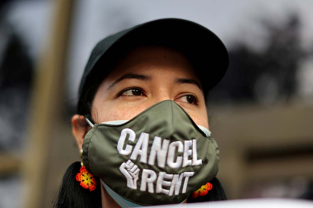 A demonstrator calling for an end to evictions is seen in Los Angeles Aug. 21, 2020, amid the coronavirus pandemic. (CNS photo/Lucy Nicholson, Reuters)