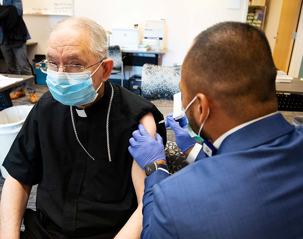 Archbishop José Gomez of Los Angeles, president of the U.S. Conference of Catholic Bishops, receives his first dose of the Pfizer COVID-19 vaccine at Providence St. John's Health Center in Santa Monica, Calif., Jan. 21. (Victor Aleman/Angelus News via CNS)