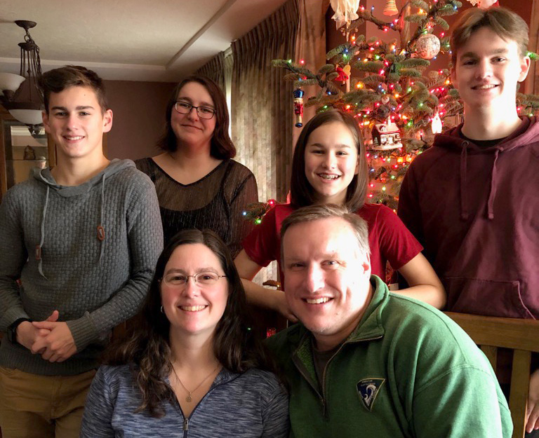 The Benson family of Alex, Natalie, Meagan, Andrew, Jenni and Mike pose for a holiday photo. Children from the Portland family have been attending St. Ignatius School for generations. (Courtesy St. Ignatius School)