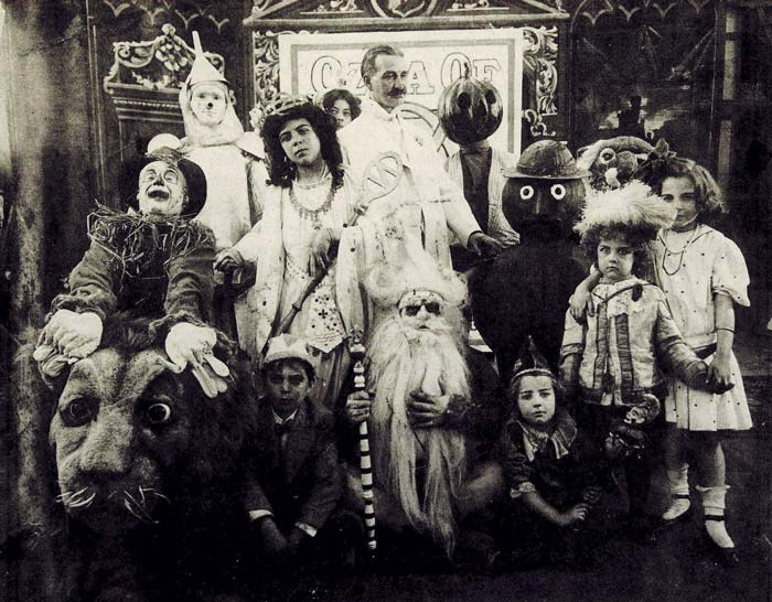 "L. Frank Baum, center, the American author of the ""Oz"" books that inspired the 1939 film ""The Wizard of Oz,"" is surrounded by characters from The Fairylogue and Radio-Plays, a traveling multimedia Oz stage show, in this 1908 photo. PBS will air a show about Baum's life called ""American Experience: American Oz"" April 19, 2021, 9-11 p.m. EDT. (CNS photo/courtesy PBS)"