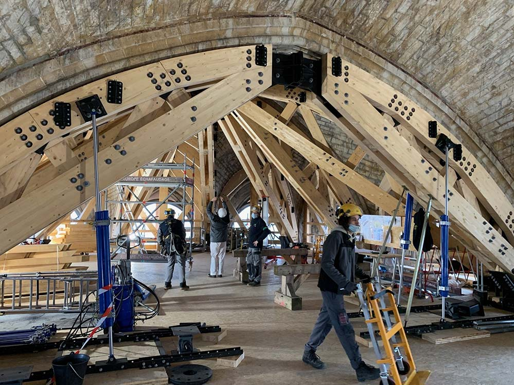 Workers are seen in an undated photo during reconstruction inside Notre Dame Cathedral in Paris. Two years after a fire destroyed much of the church's wooden structure, a fundraising group is urging people to sponsor a statue or gargoyle to help with reconstruction. (CNS photo/courtesy Etablissement Public pour la restauration de Notre-Dame de Paris )