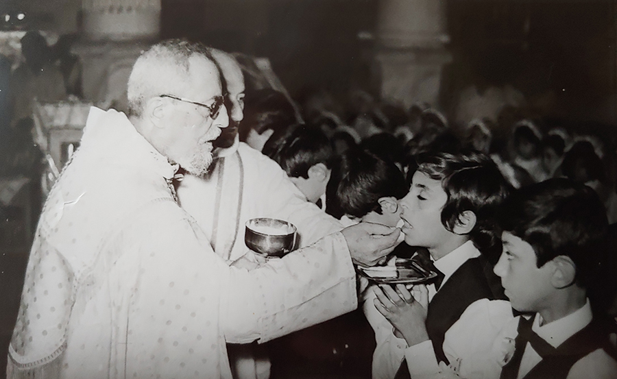 Sarmad Ghazala photographed receiving his first communion in Iraq. The Chaldean Catholic left his native Iraq 27 years ago. (Courtesy Sarmad Ghazala)