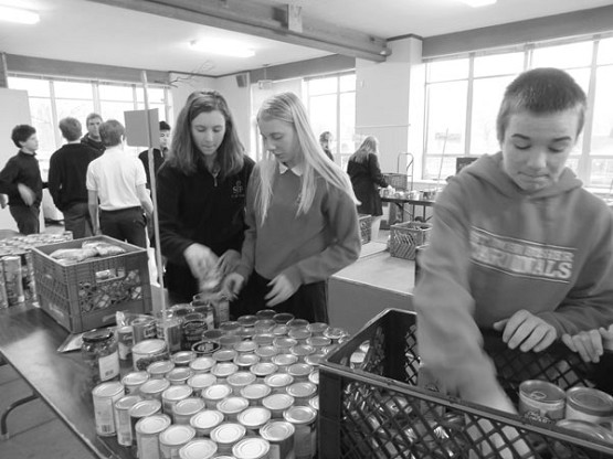 Lucy Meneghello, Lucy Balish and Kevin Blair organize food donations that were later delivered to people in need.