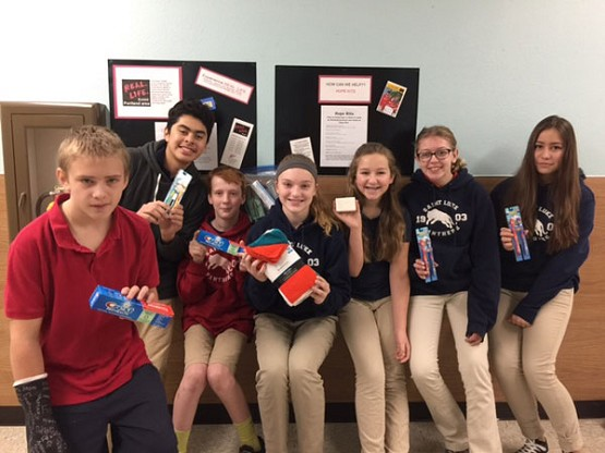 St. Luke School Middle School students collected personal care items for Hope Kits they are assembling for Medical Teams International to distribute in areas in need around the world. Showing examples are seventh graders Otto Dysinger, Fernando Alatorre, Jake Shultz, Mary Davidson, Lauren Brassel, Angelina Hostetler and Jessica Baron.