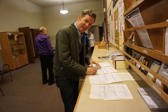 Oregon State Rep. Rob Nosse (D-Portland) signs up for ministries at St. Philip Neri Church, Portland. Rep. Nosse said his faith informed how he voted on the minimum wage measure passed on March 2.