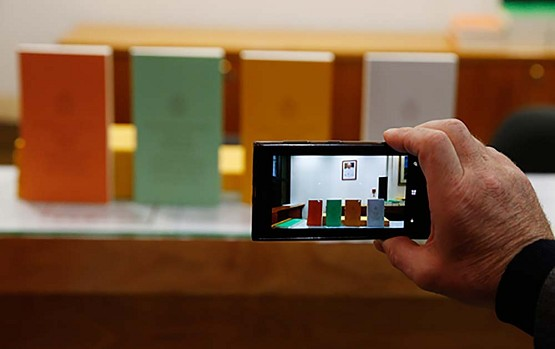 "A journalist takes photos of copies of Pope Francis' apostolic exhortation on the family, ""Amoris Laetitia"" (""The Joy of Love""), during the document's release at the Vatican April 8. The exhortation is the concluding document of the 2014 and 2015 synods of bishops on the family. (CNS photo/Paul Haring)"
