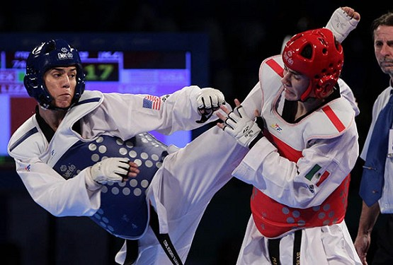 Steven Lopez of the U.S. battles with Mexican Rene Lizarraga during the 2013 Taekwondo World Championship in Mexico. Lopez, bound for his fifth Olympic Games in Rio de Janeiro, is a parishioner at St. Theresa Catholic Church in Sugar Land, Texas. (CNS photo/Ulises Ruiz Basurto)